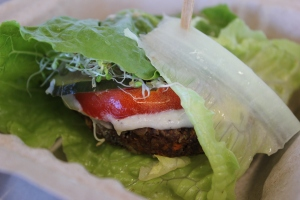 Burger patty wrapped in lettuce.